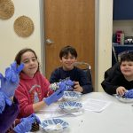 4th & 5th grade students help kindergarten & 1st grade students make bird feeders