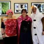 ST staff in costume on Purim 2020 - Beth Adler on the left as a jelly sandwich with a pink wig on; Babette Cohn in the middle dressed like Anna from the movie Frozen; Rabbi Jonah Layman on the right as Olaf the Snowman from the movie Frozen